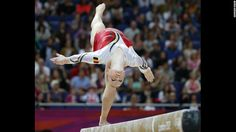 Belgian gymnast Gaelle Mys competes on the balance beam during the women's artistic gymnastics qualification event. http://www.PaulFDavis.com/success-speaker (info@PaulFDavis.com)