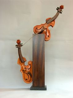 Philippe Guillerm's music-inspired sculptures are whimsical and curvaceous string instruments, he uses the theme as a way of expressing human nature and needs, you see an instrument, he sees an attitude.