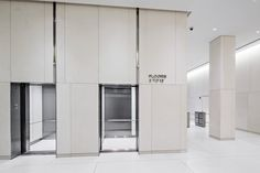 Image result for back painted glass elevator lobby