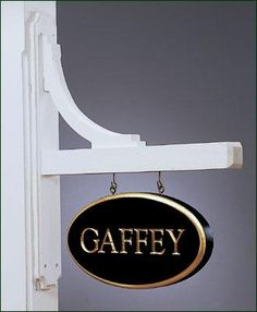 """Decorative Sign Bracket - Crafted for easy mounting to post, wall or any flat surface using just 4 screws. Mounting board dimensions: 30"""" H, 4"""" W, 3/4"""" D. Sign arm is 2 1/2"""" sq. and 24"""" L. Recommended for signs between 14"""" and 22"""" W. All cedar, stained white or Cellular Vinyl."""