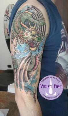 tatuaggio giapponese, tatuaggio japan, tatuaggio fantasy, tatuaggio drago, tatuaggio grande, tatuaggio artistico - tatuaggio giapponese colori drago con onde su braccio - Violet Fire Tattoo - tatuaggi maranello, tatuaggi modena, tatuaggi sassuolo, tatuaggi fiorano - Adam Raia