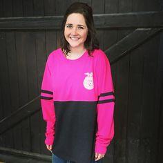 Abbey Gretsch, 2015-2016 National FFA Southern Region Vice President, sporting Shop FFA's long sleeve, hot pink and metallic varsity crew.