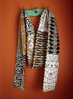 Scarf; the zig zag for edging, the bricks of fabric, not the fabrics themselves.