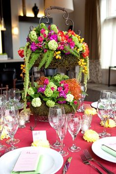 Colorful, two-tiered centerpiece by Ideas in Bloom, LLC on http://WedOverHeels.com | Photo by http://amiefedoraphotography.com