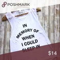 In Memory Of Sleep White Muscle Tank If you are a mom, you know the feeling of being in memory of sleep and needing coffee or wine! Our funny mom life shirt is the perfect wardrobe staple for you or gift for mom. It's uniquely soft white blend of 65% poly & 35% viscose is great for every day wear and will go well with many things already in your closet. Style is a flattering draped silhouette, with a round neckline and large arm holes. Tops Muscle Tees