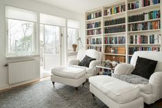 all white with wall to wall book shelves