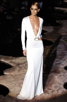 Gucci. (There is a need for this dress; A little more breast)