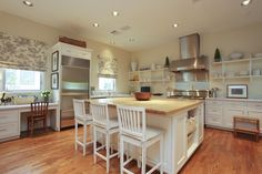 The kitchen has an over-sized wood block island for seating, open shelving,and  abundant storage. Top-end appts. include Carrara marble counter tops, Dacor 6 burner stove, Kitchen Aid convection double oven, Subzero refrigerator, U-Line ice machine.