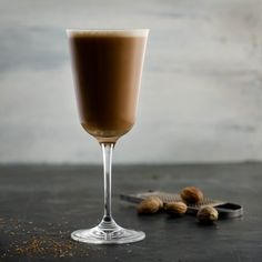 Add this to your bar menu at your next party: Dale DeGroff's Rum Flip, made with our Kilimanjaro blend. Image courtesy of Francesco Sapienza and Maeve Sheridan. Alcoholic Drinks, Beverages, Coffee Cocktails, Bar Menu, Flipping, Rum, Kilimanjaro, Make It Yourself, Tableware