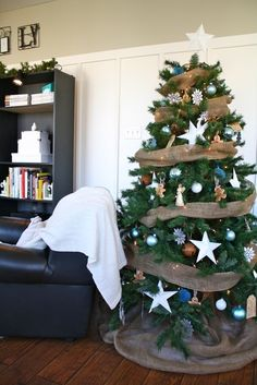 pretty, country Christmas tree with burlap garland and skirt, oversized stars