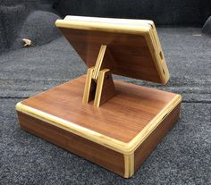 This Plywood iPad stand is made of high quality plywood. The construction of the iPad stand allows the end grain of the plywood to be seen given a unique look. Drawer has a removable plastic inset for the cash and change 3 coats of lacquer are applied to bring out the color in the