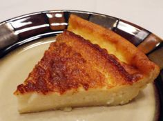 Magic Crust Custard Pie  1/4 c margarine   4 eggs  3/4 c white sugar  1 pinch salt   2 c milk, 2%   2 tsp vanilla extract   1/2 c all purpose flour  Blend all, put in sprayed pie plate.  45 min at 350, flour settles to bottom to make crust.