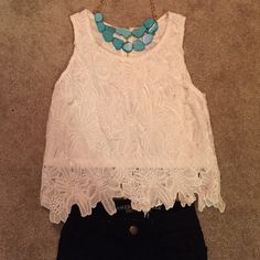 Charlotte Russe flora/ crochet top Never worn but without tags crochet top! The lining underneath is a little crop but the rest of the crochet hits right on my jean line! Charlotte Russe Tops Crop Tops