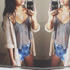 Knit Cardigan, flowy crop top, and ripped denim shorts.