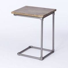 Pipe Side Table from West Elm. Basically just metal plumbing fixtures with a simple wood plank mounted on top.