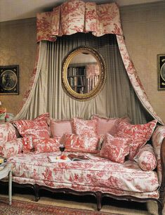Toile settee with canopy ----- I like the classic mix of prints, It keeps the toile from looking too stuffy.