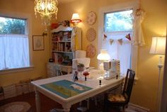 """""""anyone can quilt"""" has created this wonderful sewing room filled with her most favorite things... beautiful :)"""
