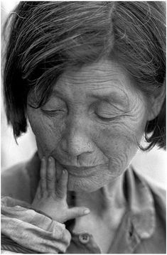 Old lady, wrinckles, aged, lines of Life, beauty, powerful face, baby hand, fingers, gesture, love, portrait, photo b/w