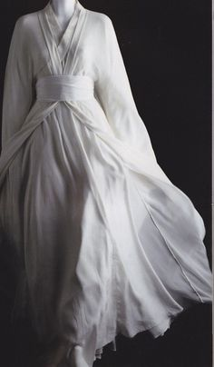 -Though it was only plain white, the fabric billowed out like a handkerchief, and for half a moment she thought the woman might blow away.