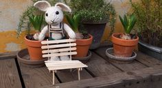 Hops builds a popsicle stick chair.
