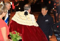 Lord Mayor Alderman Alan Yarrow (centre) and the Duke of York greet China's president Xi Jinping as he arrives at a banquet this evening