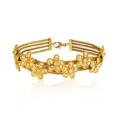 Daisy bracelet in 18KT yellow gold with diamonds.