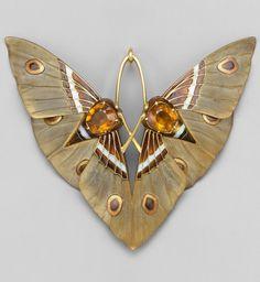 An Art Nouveau 'Moth' pendant, by Lucien Gaillard, circa 1900. Composed of gold, champlevé enamel, citrines and carved horn. #Gaillard #ArtNouveau #pendant