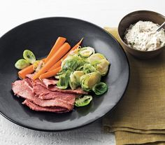 Ale-Braised Corned Beef, Brussels Sprouts, and Carrots--I spy a St. Patrick Day's meal!--Real Simple