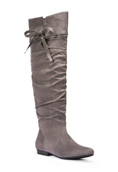Inject some drama into your relaxed separates with Romesha! This flat slouchy boot is a great casual go-to. Her low heel is optimal for every day, while the bow detail is an adorable addition. Romesha will help you make comfort totally cute!...