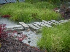 Recycled granite curbs slow the water and provide access across the ...