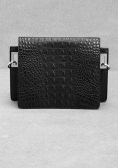 Black leather bag with a croco-embossed finish and silver-coloured hardware with an elegant, matte finish.