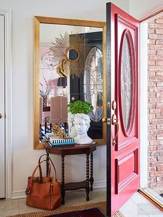 A door can't be open all the time. Deck the wall behind it with a short console table and tall mirror for an entryway you can't help but check out./