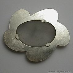 silver and glass brooch by Kobi Bosshard
