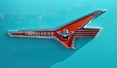 1956 Ford 312-V8 T-Bird Engine Emblem on Front Fenders.