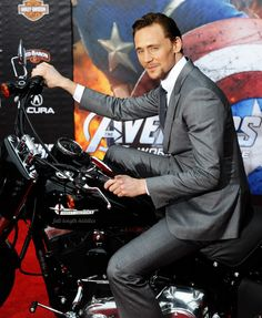 Hot damn, Tom on a motorcycle.