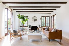 An airy neutral living room designed by Katherine Carter gets recreated for less by copycatchic luxe living for less budget home decor and design room redos