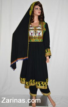 Afghan Dress Made from a light weight, cotton fabric and decorated with elegant embroideries including the hem line and cuffs. Fitted at the waist, comes with an adjustable belt. Includes an alluring silhouette with loose sleeves and a long skirt that hits just below the knee, a defining feature of traditional Afghan clothing. The embroidered pattern is intricate and stylish, decorated with mirrors, it is simple yet unique. Comes with a matching headscarf and pants.
