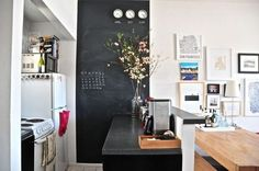 Love so many things here...picture wall, blackboard wall, spice magnets, flowering twigs.
