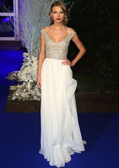 Taylor Swift at the Centrepoint Winter Whites Gala. This dress is absolutely stunning!!