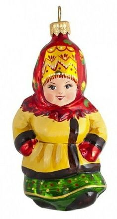 Christmas tree (New Year's tree) ornament. A smiling girl in the Russian traditional winter outfit. It is made of glass and hand-painted.