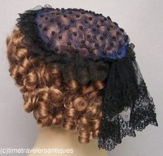 """Lovely c1860's Lady's Tulle & Lace Head-Dress, wired black tulle with handmade french knot accents, trimmed in black chantilly lace, lined in rich blue tulle with bobbin lace accent at the back.  Approximately 6"""" x 9"""""""