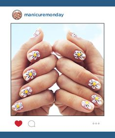 Mani of the Week: Nail guru Jessica Washick says small nails don't have to mean small nail art. She used a combo of Deborah Lippmann and Essie nail polishes with a striping brush to create this bold floral design.