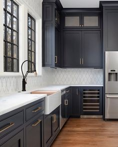 "Home Bunch on Instagram: ""Dark kitchen cabinet inspo! Go Dark: Use dark cabinetry with brass and marble accents to create a stylish kitchen or butler's pantry. The…"""