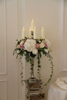 Glorious Baroque style candelabras filled with Roses, Stocks, Peonies and Hydrangeas