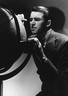 James Stewart looking at a globe, 1936.