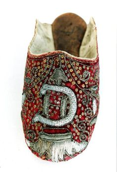 Slipper, ca. 1602, probably Danis. Silk velvet, metallic embroidery, leather. Probably made in 1602 for the wedding of Hedwig of Denmark to Christian II of Saxony.