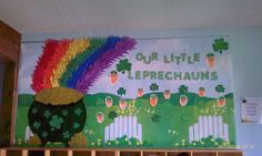 Rainbow is made of students' paper hand cutouts and leprechauns are made from painted hand prints. Happy spring!