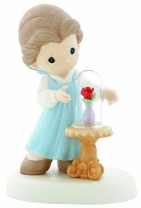 Precious Moments has done it again – a perfect portrayal of a dearly beloved Disney character: Belle. This beautiful figurine encompasses the beauty of the magical rose which plays such a big role in Belle's fairytale. This figurine is depicting a scene directly out of Disney's Beauty and the Beast film.