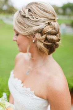 Love this updo! Unique but still classic and chic! Via http://theeverylastdetail.com/eclectic-navy-mint-peach-wedding-ideas/