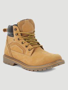 86a18d4457f Boots fourrées en cuir style chantier Jaune Les hommes actifs seront  enchantés par ces boots pour